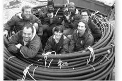 GOUGH 45 (1999-2000): Back (L-R) Beneke de Wet (Radio Technician), Peter Lekalakala (Meteorologist), Christine Haenel (Field Assistant), Victor Mafata (Meteorologist), Alex Jones (Field Assistant); Front: Kobus Steyn (Senior Meteorologist/Deputy Leader), Antwa Lombard (Medic/Leader), Aldo Strumpher (Diesel Mechanic).