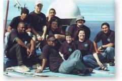GOUGH 51 (2005-2006): Back (L-R) Menthiam Sebesho (Senior Meteorologist/Deputy Leader), Phillip Lourens (Meteorologist), Floyd Chubane (Radio Technician); Middle: Steven Phakula (Meteorologist), Johnny Wilson (Biologist), Fanie Potgieter (Diesel Mechanic); Front: Given Moreku (Sagina), Marie Burle (Biologist), Tamara Spinks (Medic/Leader), Ivan Green (Sagina).